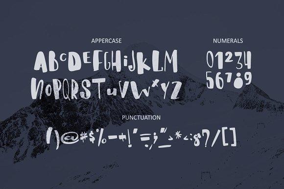 Whitey Handwritten brush font.